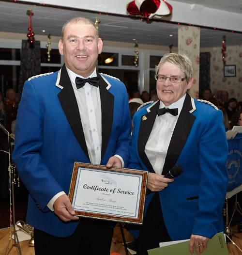 Sheila Walton, NW Area Brass Band Committee Member, presenting 40 Years Service Award to Steve Sharpe