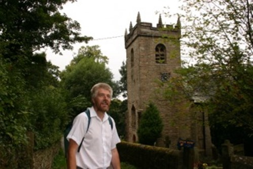 David Frith walking past St James', Taxal. He led walks at heritage weekends, bringing the party back for tea.